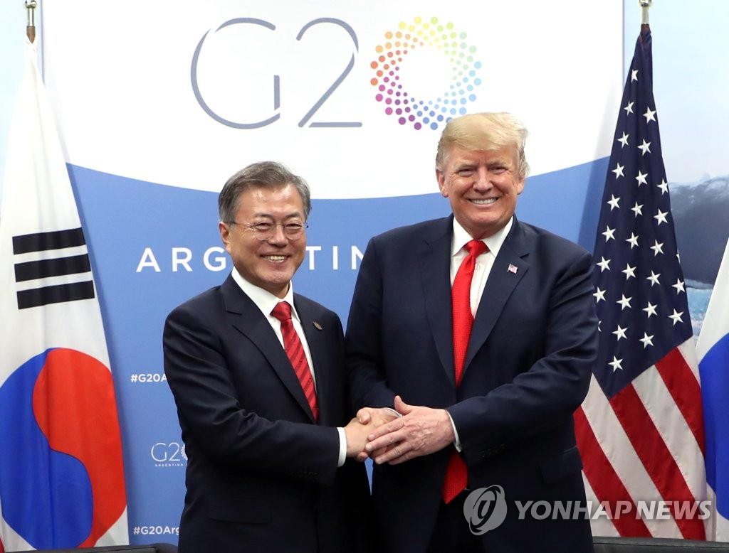 South Korean President Moon Jae-in (L) and U.S. President Donald Trump shake hands before the start of their bilateral summit on the sidelines of the Group of 20 Leaders' Summit in Buenos Aires on Nov. 30, 2018. (Yonhap)