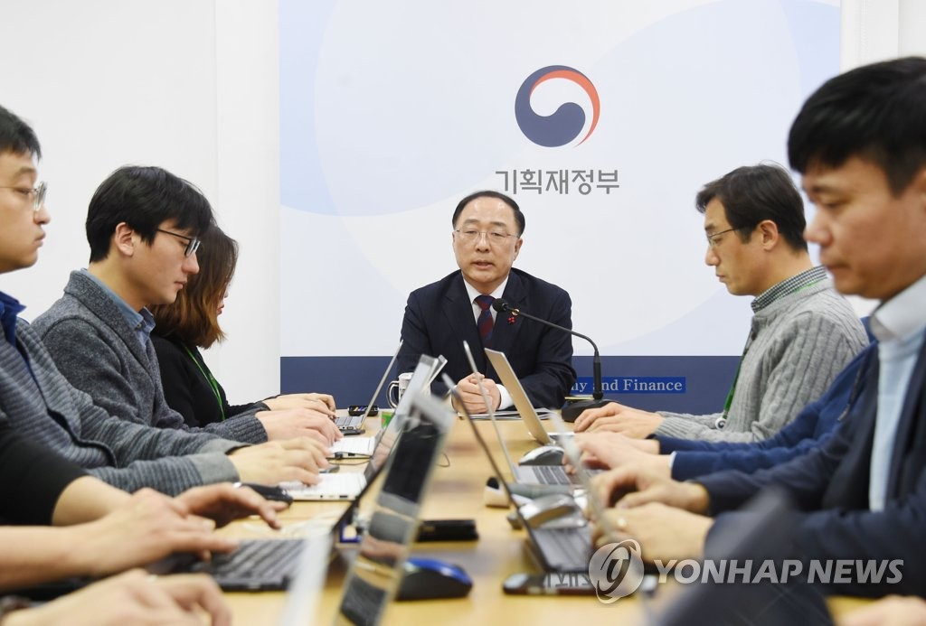 Hong Nam-ki, the minister of economy and finance, holds a meeting with reporters at the ministry building inSejong, central South Korea, on Dec. 11, 2018. This photo was provided by the Ministry of Economy and Finance. (Yonhap).