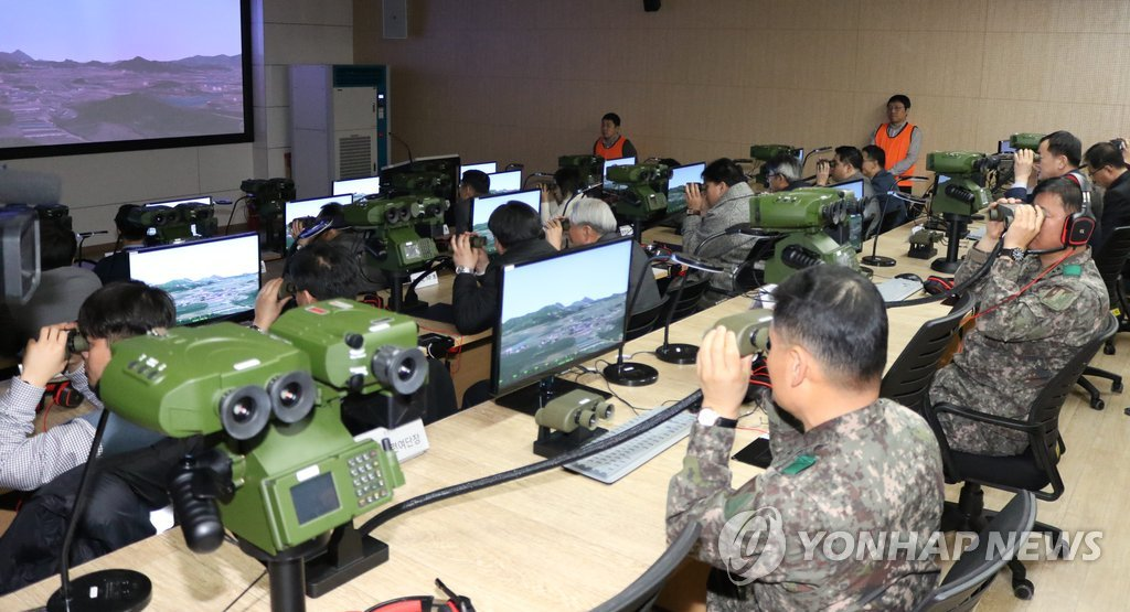 Military officials attend an event marking the deployment of an indigenous high-tech counter-fire simulator in a field artillery school of the Army Training & Doctrine Command in Jangseong, some 300 kilometers south of Seoul, on Feb. 12, 2019, in this photo provided by the Defense Acquisition Program Administration. (Yonhap)