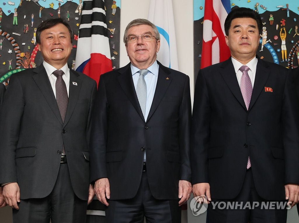 In this file photo from Feb. 15, 2019, South Korean Sports Minister Do Jong-hwan (L), International Olympic Committee (IOC) President Thomas Bach (C) and North Korean Sports Minister Kim Il-guk pose for photos before the start of their working meeting on inter-Korean sports cooperation at the IOC headquarters in Lausanne, Switzerland. (Yonhap)