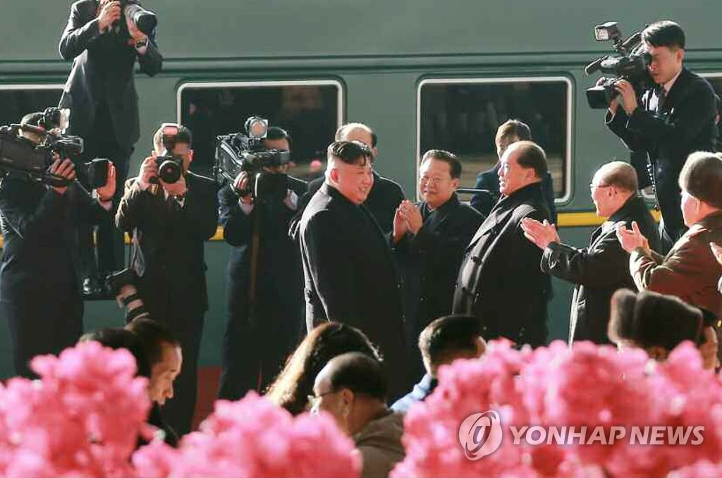 North Korean leader Kim Jong-un (C) is sent off by his top officials as he boards a train bound for Hanoi for a second summit with U.S. President Donald Trump, in this picture published in the Rodong Sinmun, the North's main state newspaper, on Feb. 24, 2019. (For Use Only in the Republic of Korea. No Redistribution) (Yonhap)