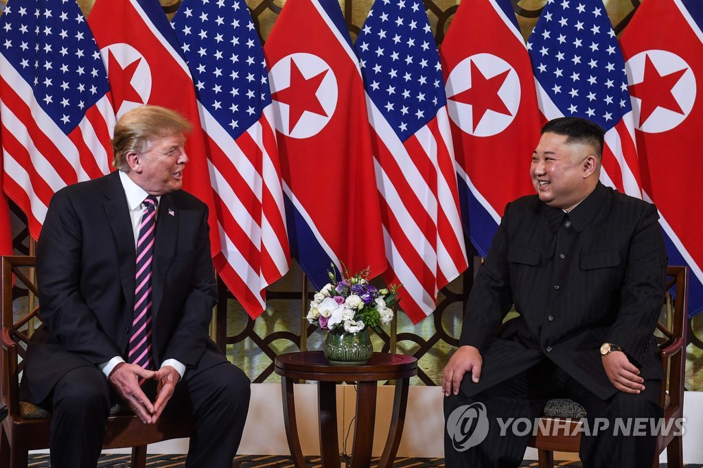 This AFP photo shows U.S. President Donald Trump (L) speaking to North Korean leader Kim Jong-un in a meeting in Hanoi on Feb. 27, 2019. (Yonhap)