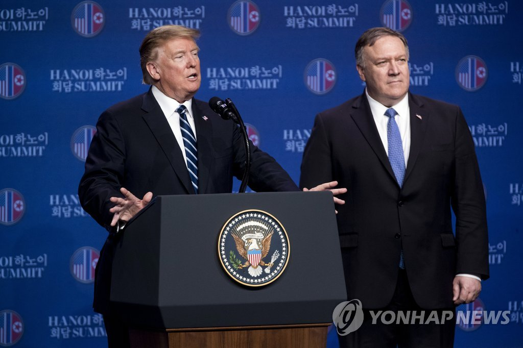 This AP photo shows President Donald Trump speaking to reporters, with Secretary of State Mike Pompeo standing next him, at a Hanoi hotel on Feb. 28, 2019. (Yonhap)