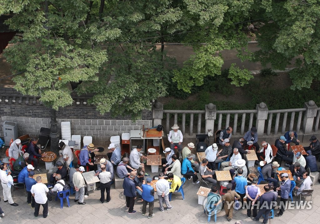 This photo, taken on June 2, 2019, shows elderly people gathering at Tapgol Park in central Seoul to spend their free time. (Yonhap)