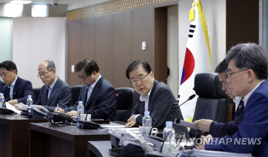 In this photo from Aug. 2, 2019, provided by Cheong Wa Dae, Chung Eui-yong (3rd from R), head of Cheong Wa Dae's national security office, presides over a meeting of security-related ministers in response to North Korea's projectile launch. (PHOTO NOT FOR SALE) (Yonhap)