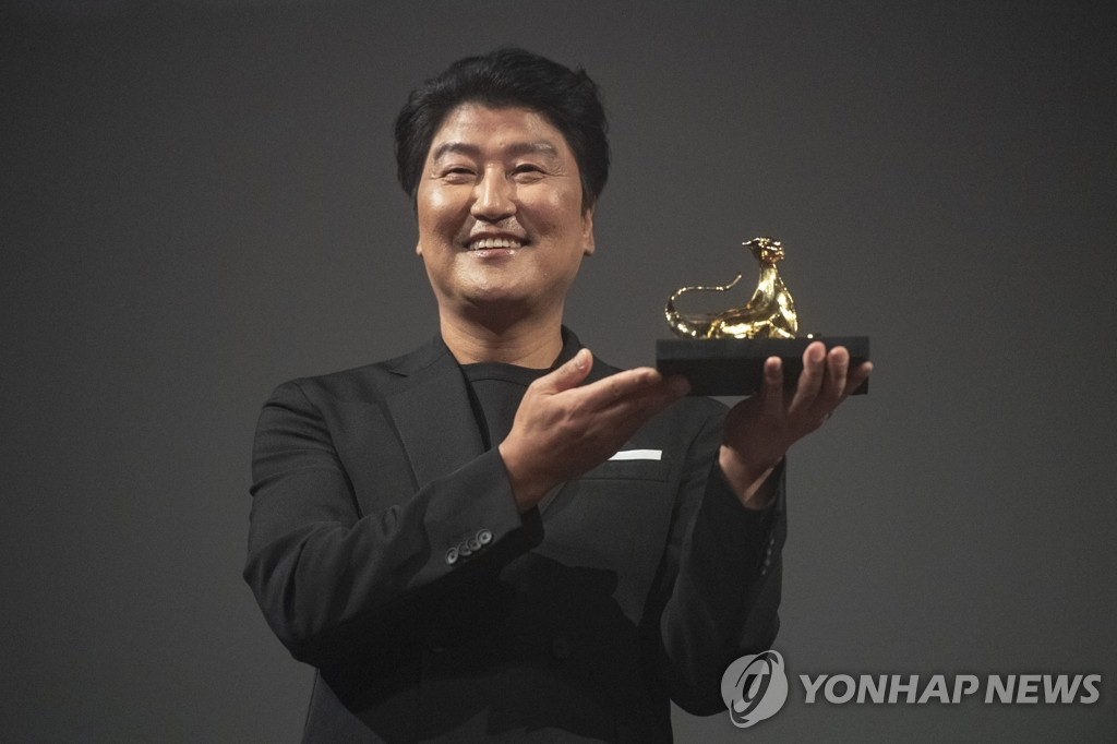 In this photo by the EPA, South Korean actor Song Kang-ho poses after winning the Excellence Award at the 72nd Locarno International Film Festival in Locarno, Switzerland, on Aug. 12, 2019.