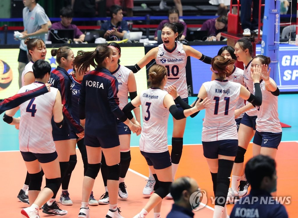 S. Korean volleyball players celebrate after win