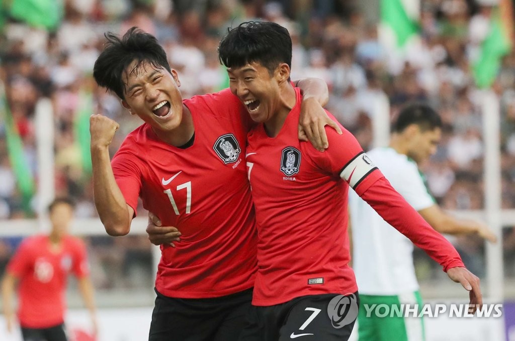 Na Sang-ho of South Korea (L) celebrates his goal against Turkmenistan with his teammate Son Heung-min during the teams' Group H match in the second round of the Asian qualification for the 2022 FIFA World Cup at Kopetdag Stadium in Ashgabat, Turkmenistan, on Sept. 10, 2019. (Yonhap)