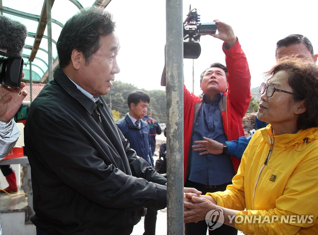 Prime minister visits typhoon-hit town