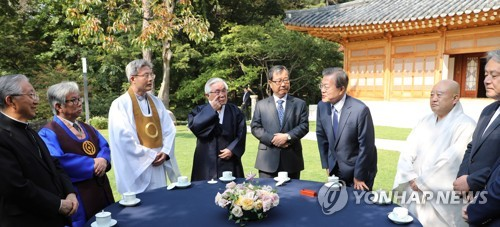 Moon asks religious leaders to help heal social conflicts
