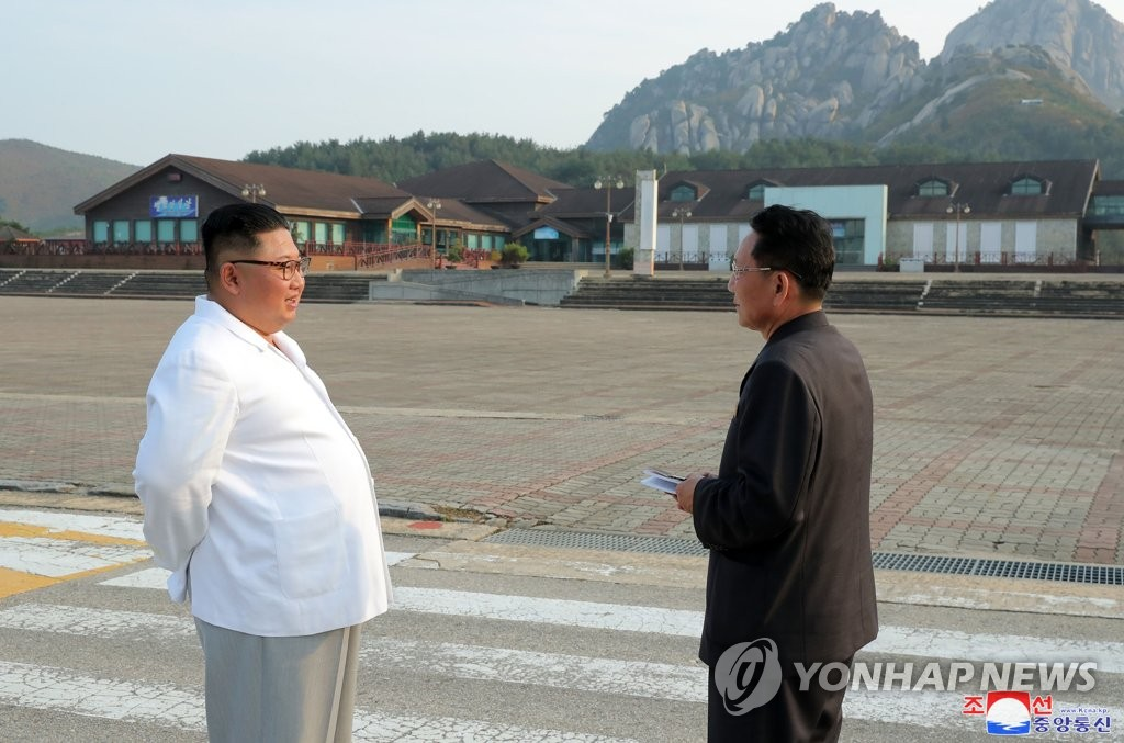 North Korean leader Kim Jong-un (L) talks with an official during his visit to Mount Kumgang on the east coast, in this photo released by the state media Korean Central News Agency (KCNA) on Oct. 23, 2019. (For Use Only in the Republic of Korea. No Redistribution) (Yonhap)
