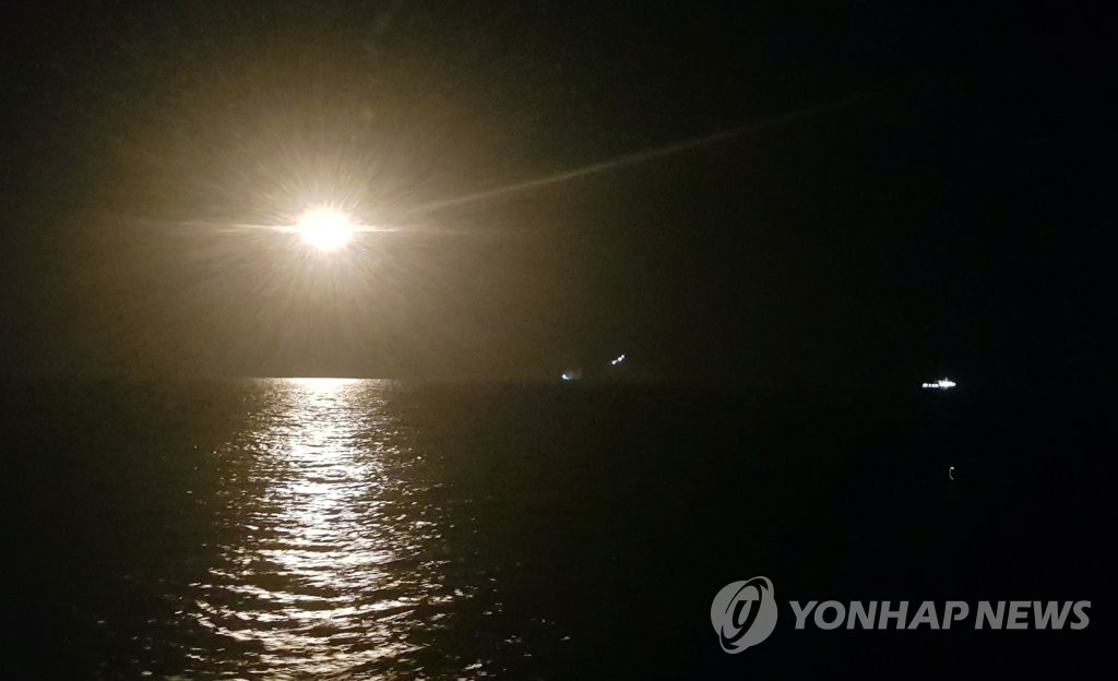 Overnight search operations are under way in waters near Dokdo on Nov. 2, 2019. (Yonhap)