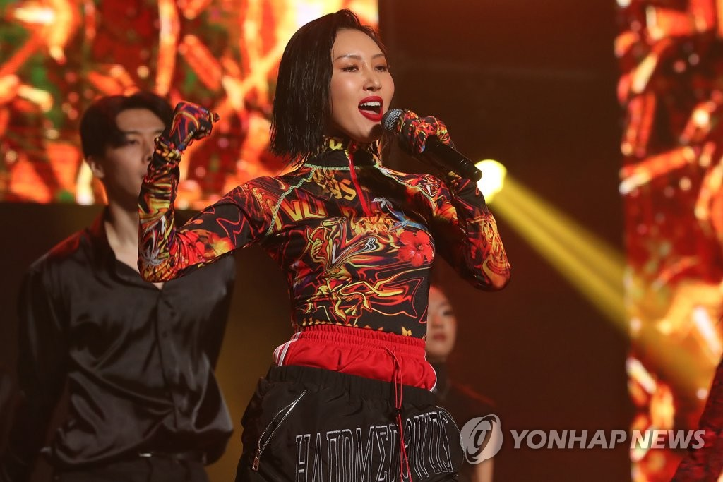 "This file photo shows Hwasa, a member of South Korean girl group Mamamoo, performing during a showcase for the group's second album ""reality in BLACK"" in Seoul on Nov. 14, 2019. (Yonhap)"