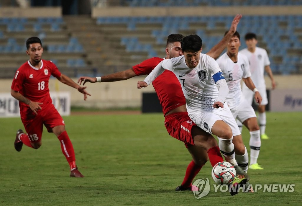 In this file photo from Nov. 14, 2019, Son Heung-min of South Korea (R) tries to dribble past a Lebanese defender during the teams' Group H match in the second round of the Asian qualification for the 2022 FIFA World Cup at Camille Chamoun Sports City Stadium in Beirut. (Yonhap)