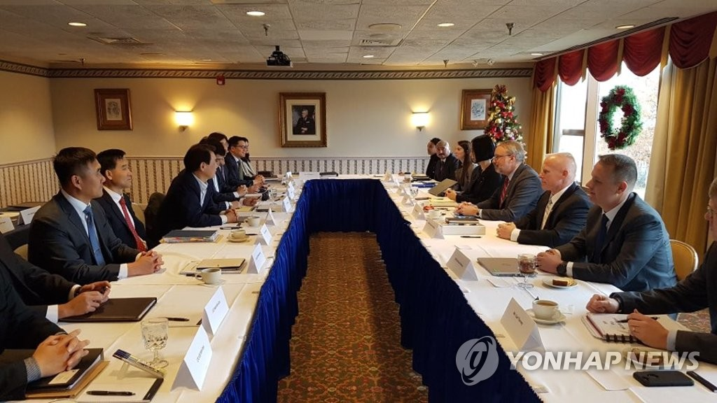 South Korean and U.S. negotiators engage in defense cost-sharing talks in Washington on Dec. 4, 2019, in this photo provided by the South Korean Embassy. (PHOTO NOT FOR SALE) (Yonhap)