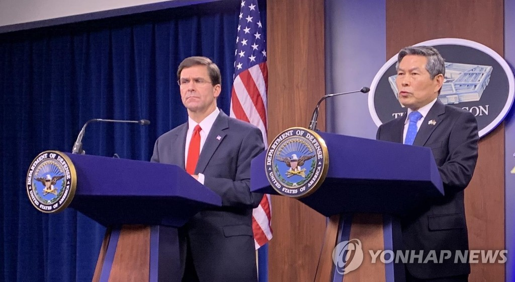In the photo, taken Feb. 24, 2020, U.S. Secretary of Defense Mark Esper (L) and his visiting South Korean counterpart, Jeong Kyeong-doo, are seen holding a joint press conference following their bilateral talks at the Pentagon. (Yonhap)