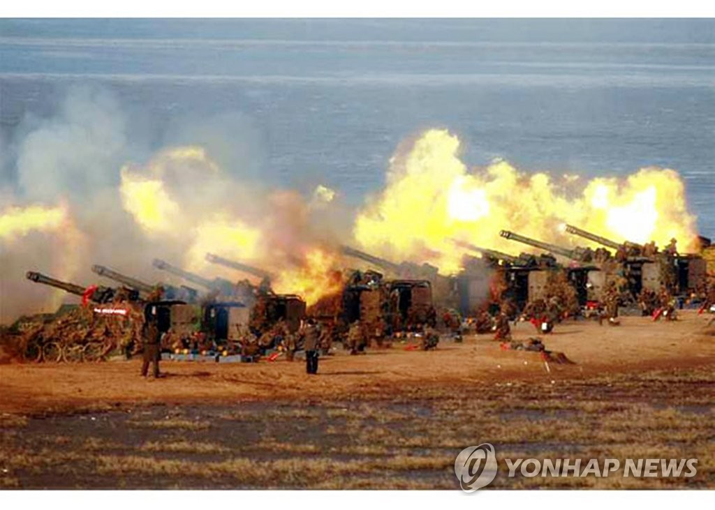 This photo released on March 21, 2020, by the Rodong Sinmun, the North's official newspaper, shows North Korean soldiers engaging in an artillery fire drill held a day earlier. (PHOTO NOT FOR SALE. No Redistribution) (Yonhap)