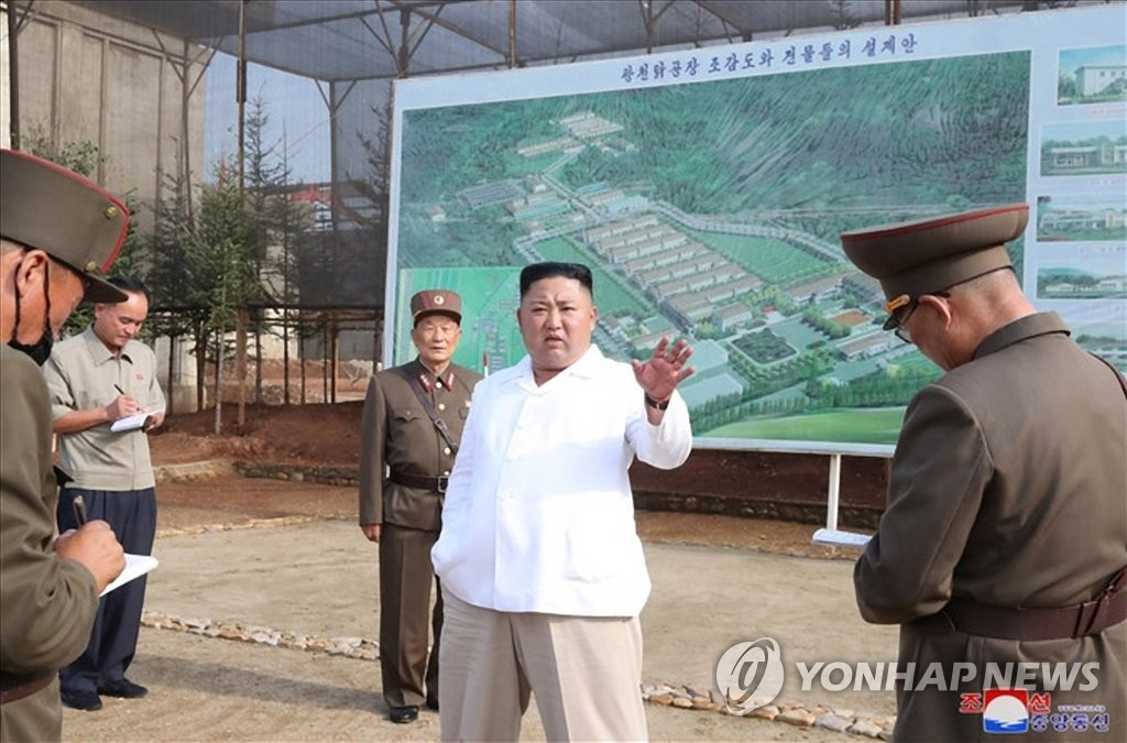 "North Korean leader Kim Jong-un (C) speaks during a ""field guidance"" trip to a chicken farm under construction, in this photo released by the Korean Central News Agency on July 23, 2020. (For Use Only in the Republic of Korea. No Redistribution) (Yonhap)"