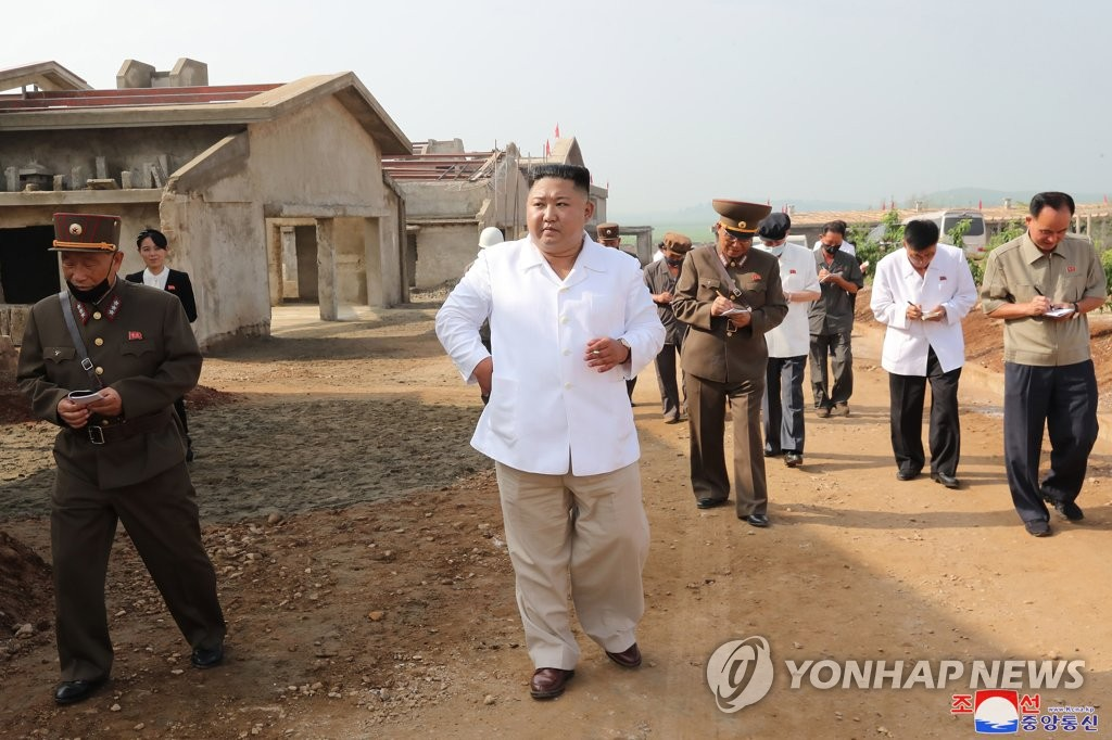 North Korean leader Kim Jong-un (C) inspects the construction site of a chicken farm in Kwangchon-ri, Hwangju, North Hwanghae Province, in this undated photo provided by the Korean Central News Agency on July 23, 2020. (For Use Only in the Republic of Korea. No Redistribution) (Yonhap)