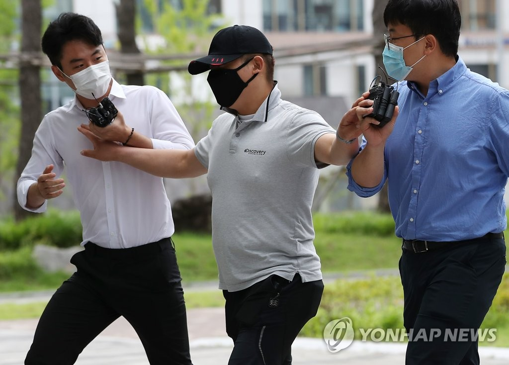 A 31-year-old taxi driver who was accused of causing the death of a patient in an ambulance he collided with attends a hearing at Seoul Eastern District Court in Songpa Ward of Seoul on July 24, 2020. (Yonhap)