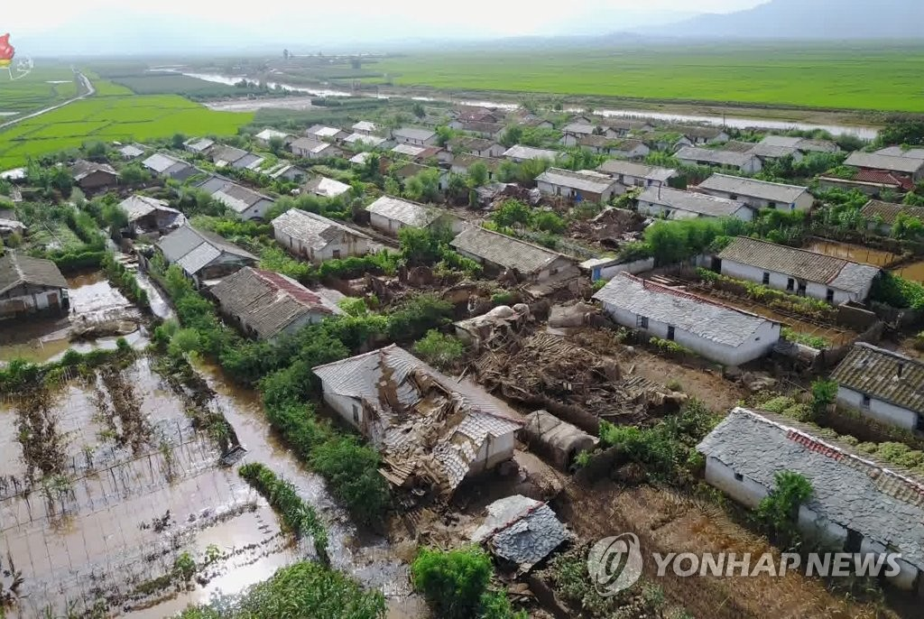 In this photo, captured from the Korean Central Television Broadcasting Station on Aug. 7, 2020, many houses are damaged and flooded at a flood-ravaged village in Unpha, North Hwanghae Province, which North Korean leader Kim Jong-un visited. The broadcaster stopped short of saying when he made the visit, but Kim is believed to have visited the village the previous day. (For Use Only in the Republic of Korea. No Redistribution) (Yonhap)