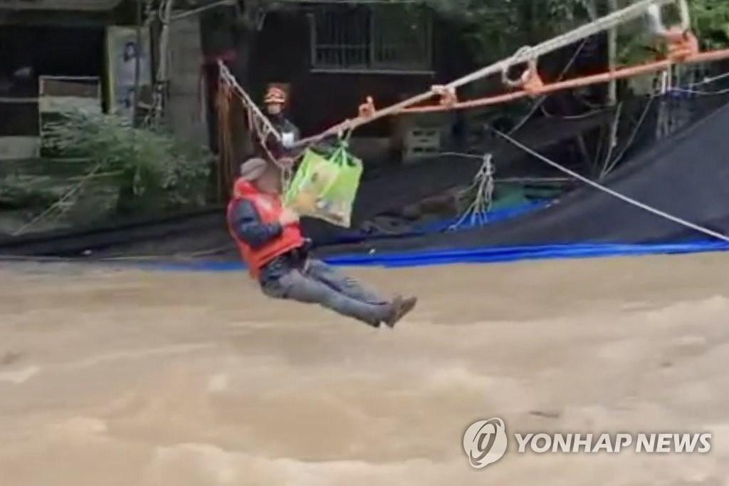 Rescue operations at flooded tourist pension