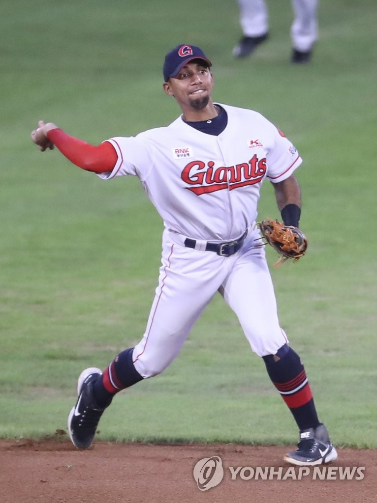 In this file photo from Aug. 27, 2020, Lotte Giants' shortstop Dixon Machado makes a throw to first base during a Korea Baseball Organization regular season game against the Kiwoom Heroes at Sajik Stadium in Busan, 450 kilometers southeast of Seoul. (Yonhap)