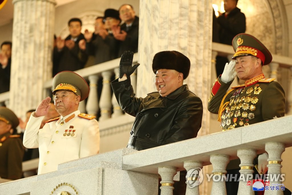 North Korean leader Kim Jong-un (C) acknowledges the crowd during a military parade at Kim Il-sung Square in Pyongyang on Jan. 14, 2021, to celebrate the recently-concluded eighth congress of the North's ruling Workers' Party, in this photo released by the North's official Korean Central News Agency the next day. (For Use Only in the Republic of Korea. No Redistribution) (Yonhap)