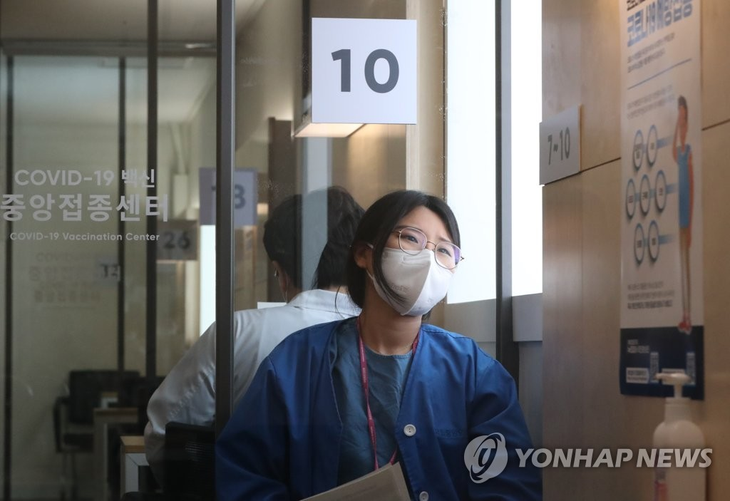 A nurse stands by after receiving Pfizer's COVID-19 vaccine at a hospital in central Seoul on Feb. 27, 2021. (Pool photo) (Yonhap)