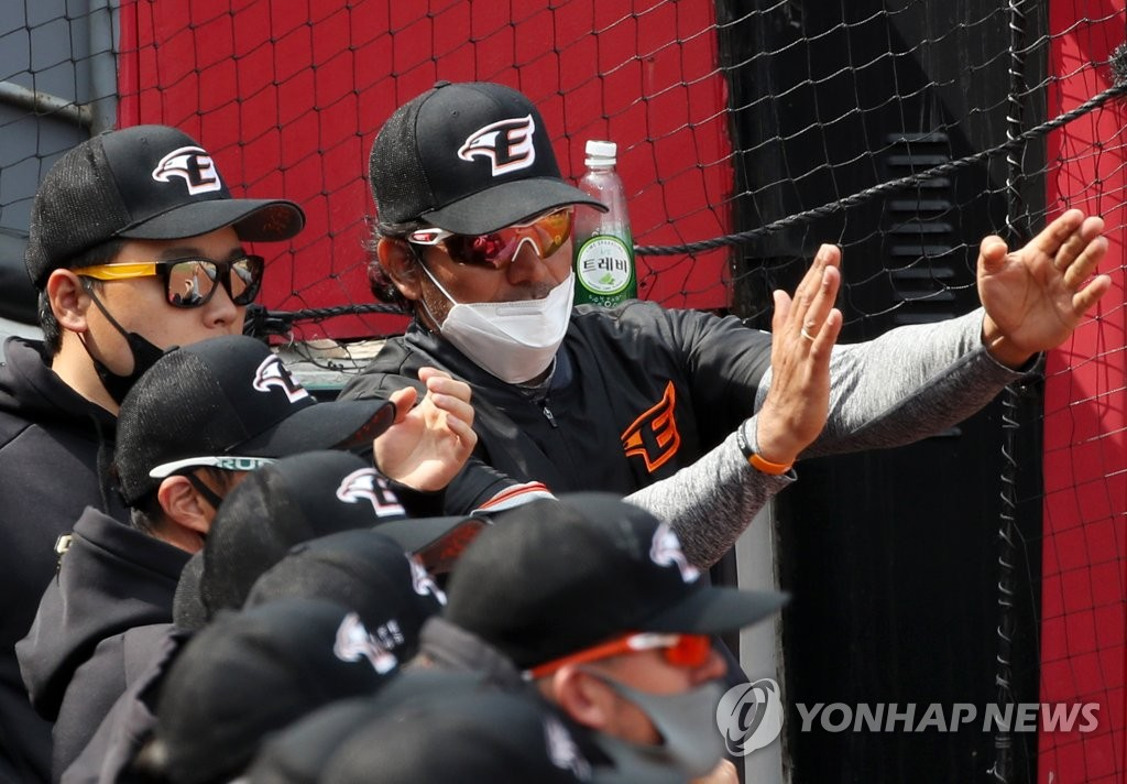 In this file photo from March 14, 2021, Hanwha Eagles' manager Carlos Subero (R) positions his infielders during a Korea Baseball Organization spring training game at Gwangju-Kia Champions Field in Gwangju, 330 kilometers south of Seoul. (Yonhap)