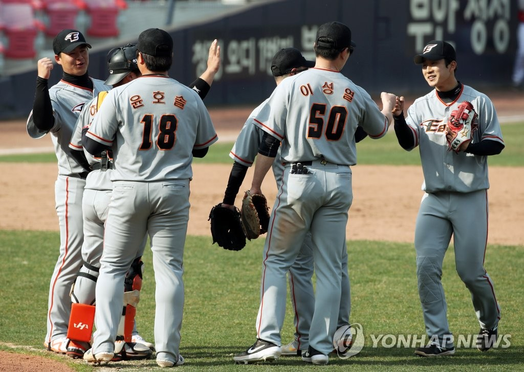 In this file photo from March 14, 2021, Hanwha Eagles players celebrate their 4-1 victory over the Kia Tigers in a Korea Baseball Organization spring training game at Gwangju-Kia Champions Field in Gwangju, 330 kilometers south of Seoul. (Yonhap)