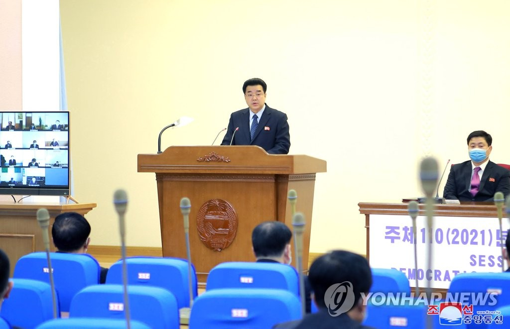This file photo, released by the Korean Central News Agency, shows North Korea's Sports Minister Kim Il-guk (standing), also chairman of the North's Olympic Committee, making a business report for this year during the committee's general assembly in Pyongyang on March 25, 2021. The North's sports ministry said on its homepage on April 6 that the North will not participate in the Tokyo Olympic Games set for July 23-Aug. 8 due to concerns over the coronavirus pandemic. (For Use Only in the Republic of Korea. No Redistribution) (Yonhap)