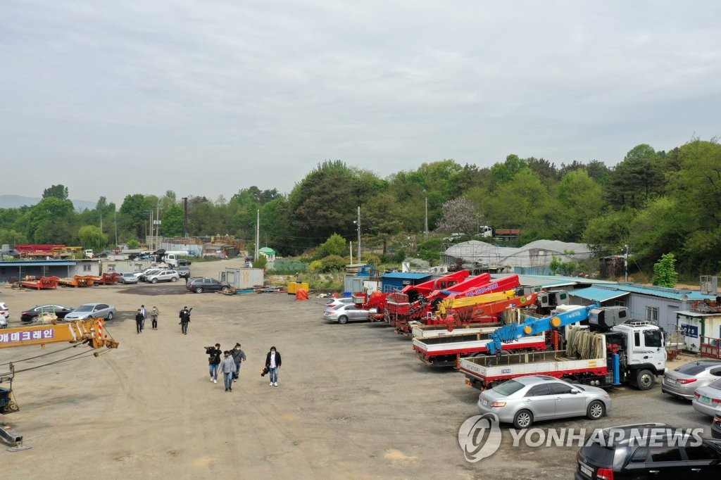 This April 23, 2021, photo shows a plot of agricultural land owned by football star Ki Sung-yueng and his father in the southwestern city of Gwangju. It was illegally altered into a parking lot for crane trucks. (Yonhap)