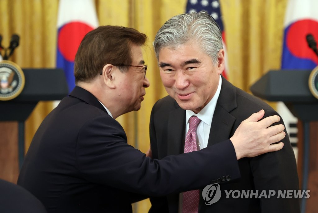 Sung Kim (R), new U.S. special representative for North Korea, smiles after President Joe Biden announced his appointment as the chief nuclear envoy for the North, at the White House, on May 22, 2021. (Yonhap)