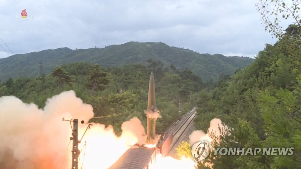 This photo, captured from North Korea's official Korean Central Television on Sept. 16, 2021, shows a short-range ballistic missile being fired from a train in a central mountainous area of the North the previous day. (For Use Only in the Republic of Korea. No Redistribution) (Yonhap)